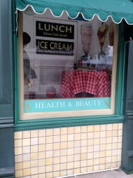 We giggled at the Health & Beauty in the same window as Ice Cream!